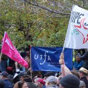 Flags and banners at rally, including UTFA banner, CUPE Ontario banner, and CUPE 3903 banner