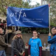 Photo of attendees at rally, including OCUFA and UTFA staff and executive members.